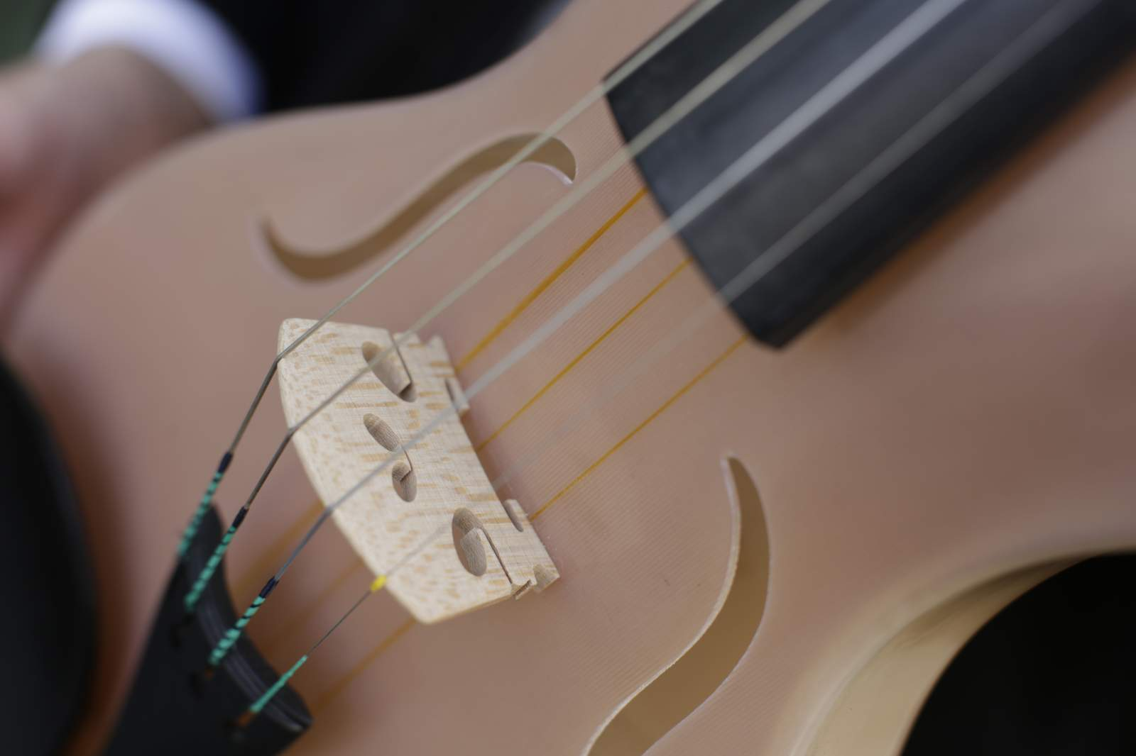 Luca's Violin made from composite material that includes spiders' silk